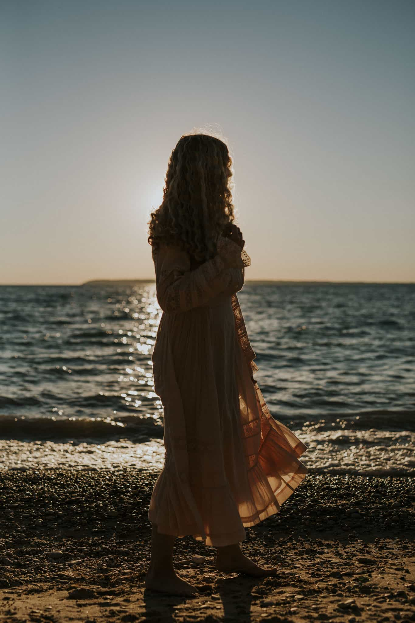 Sunset on a beach in northern michigan during a senior portrait session